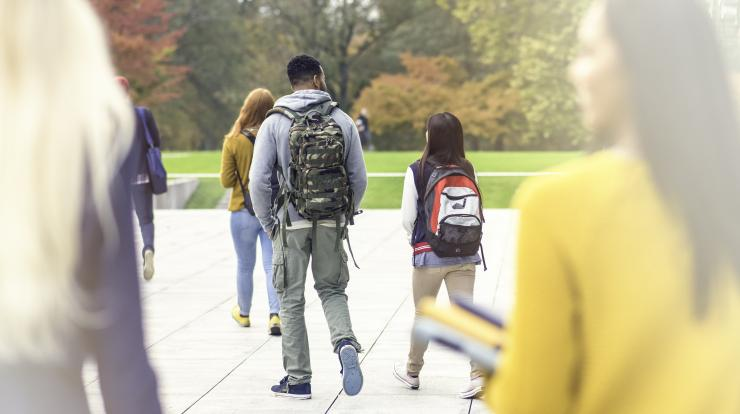 college-aged students with backpacks