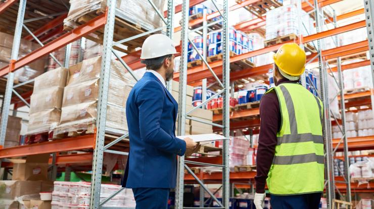 employer at warehouse with employee