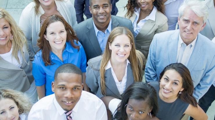 diverse group of employees looking up at the camera