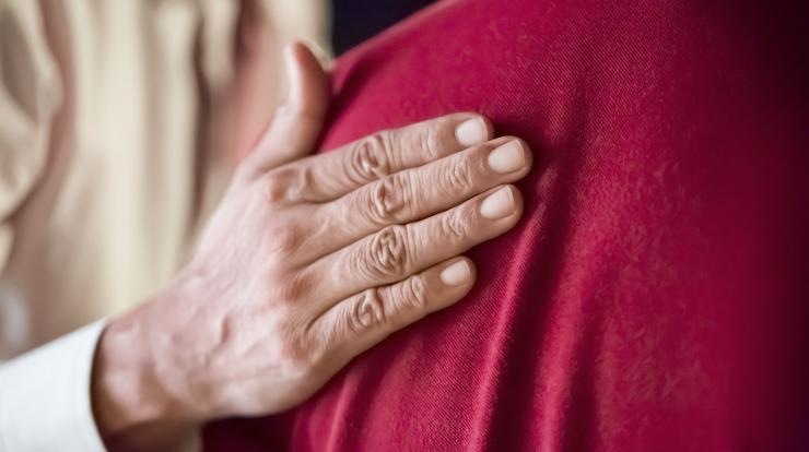 caring hand on shoulder, close up