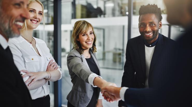 Business execs shaking hands