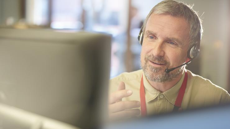 mature CareerForce specialist on the phone helping a caller