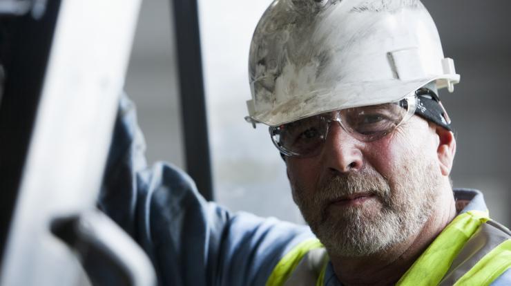 mature construction worker close up