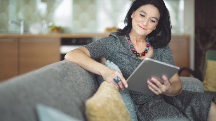 Mature woman smiling looking at laptop