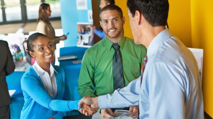 people networking at a career fair