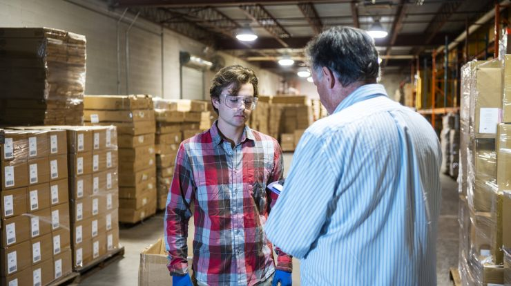 supervisor and young employee in warehouse