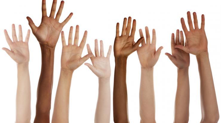 hands raised in air