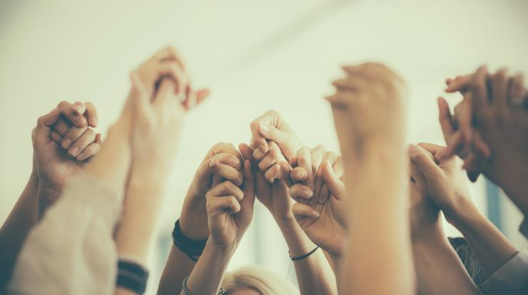 hands up reaching, celebrating success