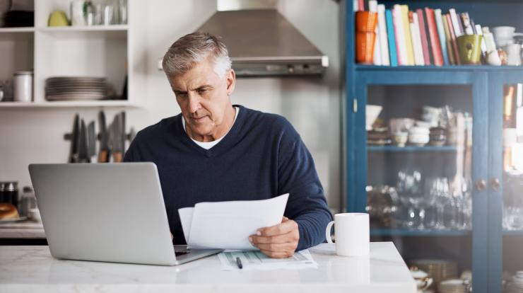 mature man at laptop