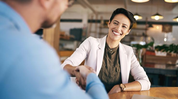 woman shaking hands with employer