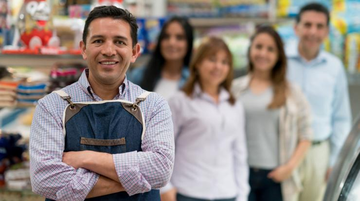 employer with store employees in the background