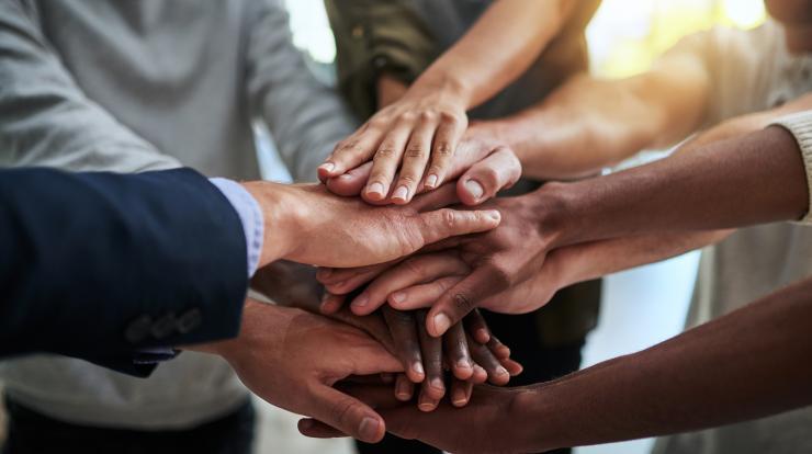 many hands together