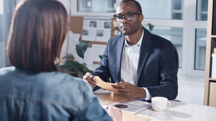 manager in meeting with employee