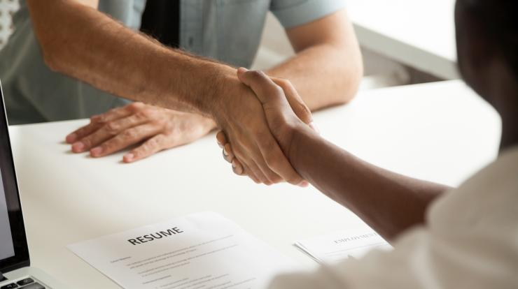 employer and employee shaking hands