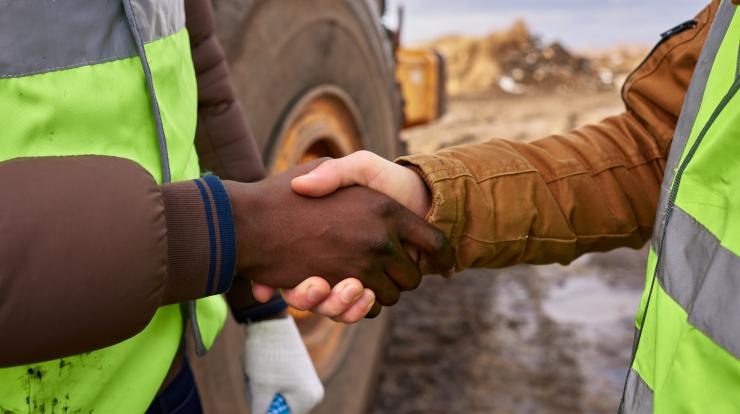diverse hands, handshake at a construction site