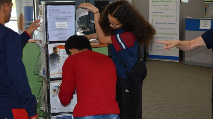 photo of teens engaged in an escape room activity where they unlock keys by doing career exploration