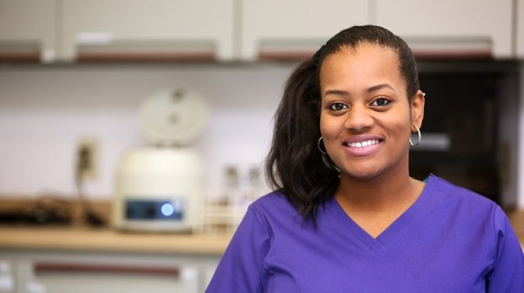 picture of woman in scrubs in health care setting