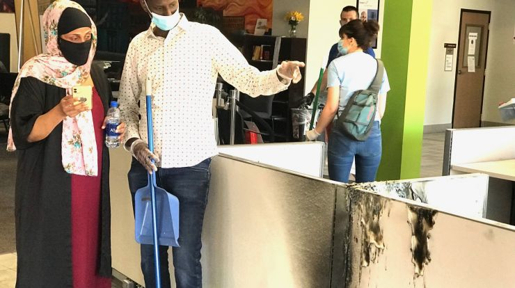 Hamse Warfa joins others in cleaning up CareerForce Minneapolis - South after vandalism and fire