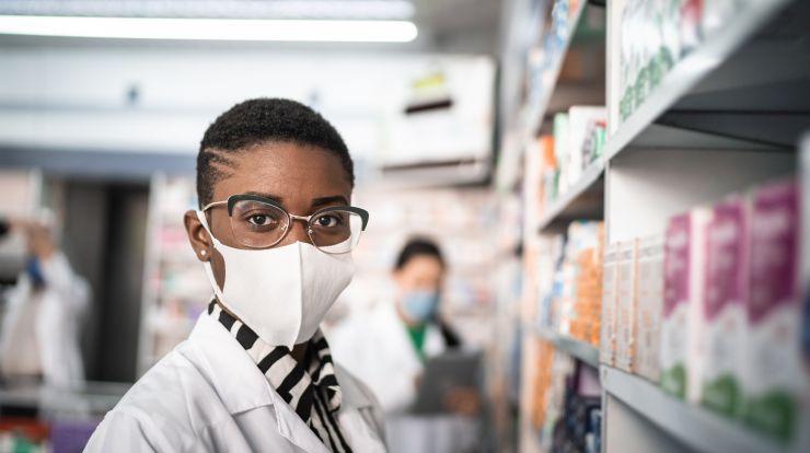 Pharmacy worker wearing a mask