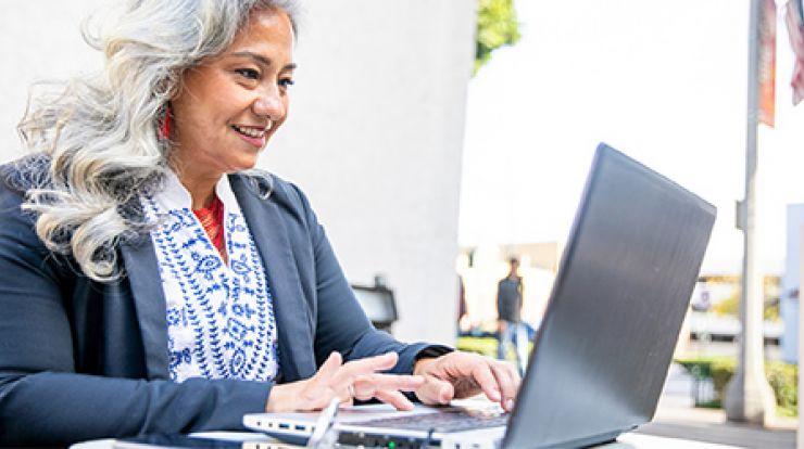 Latino woman on laptop