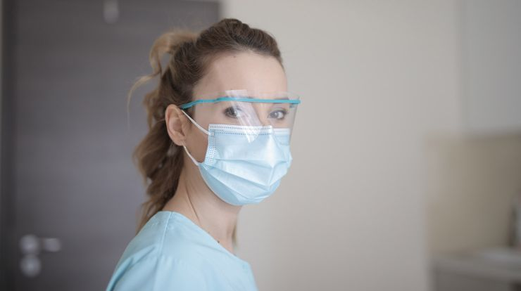 Healthcare worker wear a face mask and protective glasses