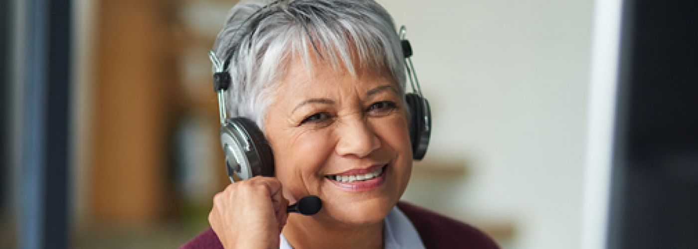 smiling woman on phone headset