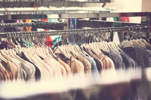 clothing on racks at retail clothing store