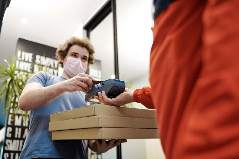 picture of pizza delivery driver wearing mask