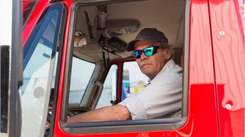 man driving a large truck