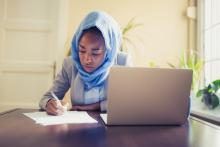 young woman working on her resume