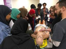 image of students working with employer on medical example workstation at EPIC event